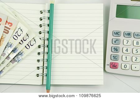 A Note Book With Pencil ..