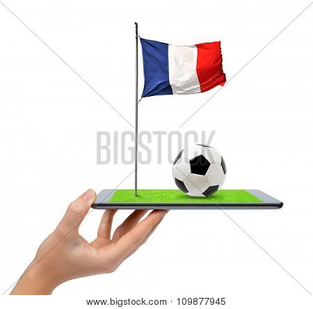 Hand holding digital tablet pc with soccer ball and French flag