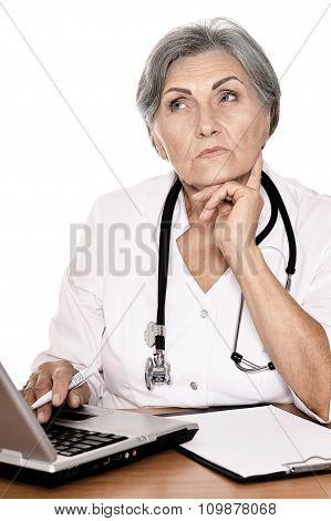 Senior female doctor with laptop