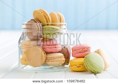 sweet french macarons in jar on kitchen table