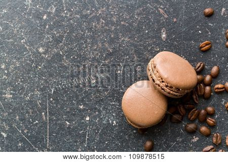 macarons with coffee flavor on old table