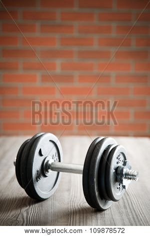 the iron dumbbell on wooden floor