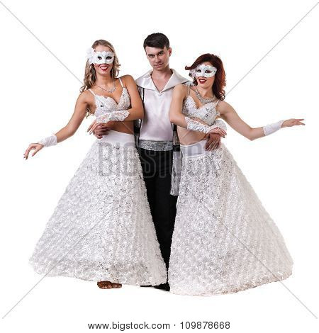 Three carnival dancers wearing a mask dancing, isolated on white