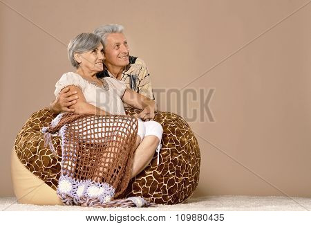 Elderly couple sitting on chair