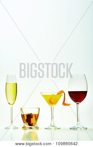 set with different drinks on white background