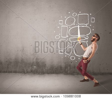 A comic hipster guy shouting in front of grey urban concrete wall with drawn empty text bubbles around his mouth concept