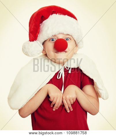 girl in santa hat with clown nose, yellow toned