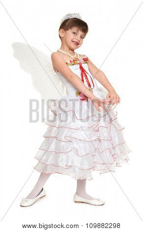 tooth fairy girl dressed in white with wings