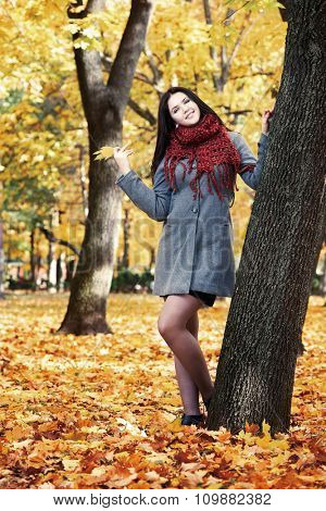 beautiful young girl portrait in yellow city park, fall season