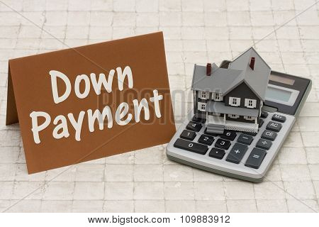 Home Mortgage Down Payment, A Gray House, Brown Card And Calculator On Stone Background