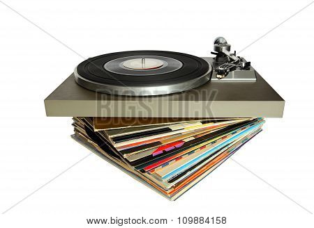 Vintage Record Player On A Stack Of Old Vinyls Isolated