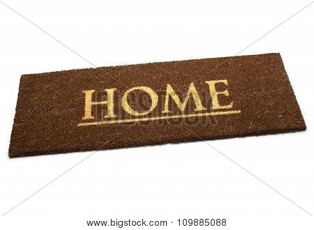 Brown carpet doormat with text Home