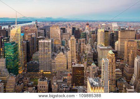 Aerial New York City skyline urban skyscrapers at dusk, USA.