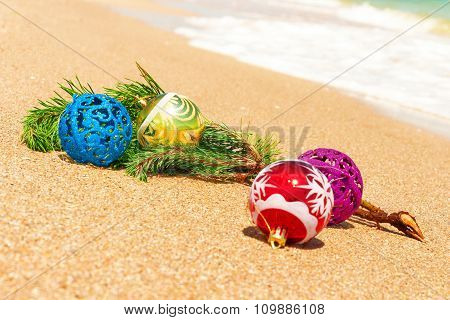 Christmas Balls With Fir Twig On Sand