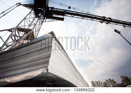 Crane and stack of steel plates