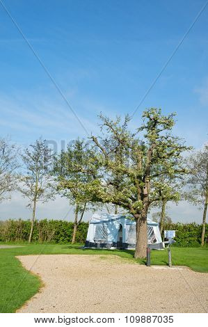 Campground with caravan in spring