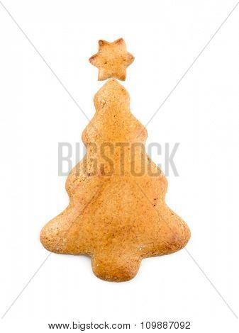 Christmas tree-like gingerbread cookie on white background