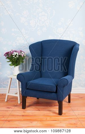Blue arm chair in vintage interior
