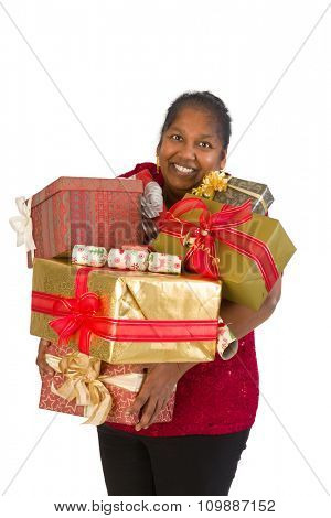 Smiling mature woman holding too many christmas presents