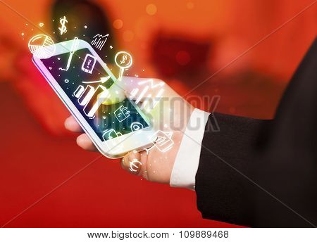 Smartphone with finance and market icons and symbols concept