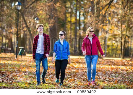 People walking in city park
