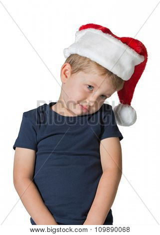 Adorable three year old boy in red cap of Santa Claus. The child has sad blue eyes and blond soft hair. Photo executed on a white background