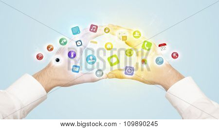 Hands creating a form with colorful mobile app icons in the center