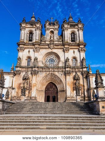 Portugal. Main entrance to the cathedral in Portuguese town of Alcobaca. Built in Baroque style