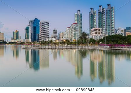 City office building with water reflection