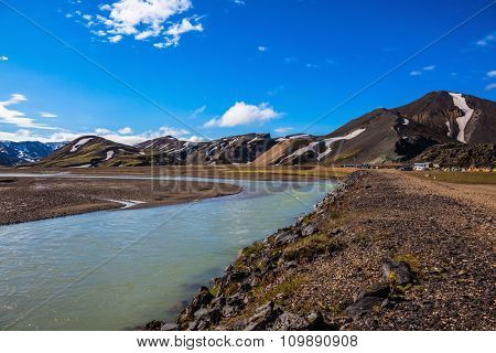 Summer floods blocked the way to the tourist camping. Central Valley in the national park Landmannalaugar, Iceland