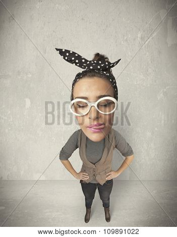Funny girl with big head, grunge wall background