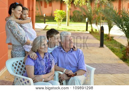Family relaxing at vacation resort