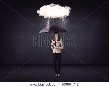Businesswoman standing with umbrella and little storm cloud concept on background