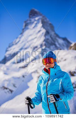Skier woman with view of Matterhorn on a clear sunny day - Zermatt, Switzerland