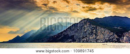 Panorama of Garda Lake at dramatic sunset, Lago di Garda Italy.