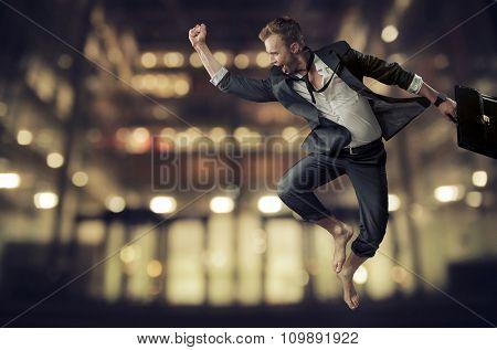 Successful businessman jumping