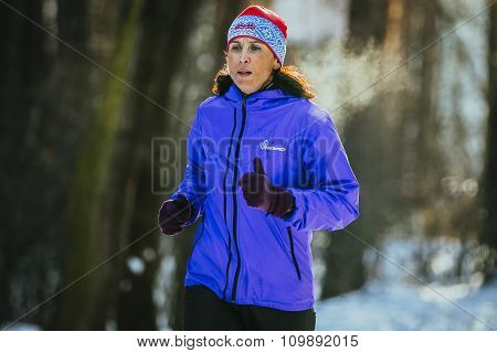 middle-aged woman athlete running