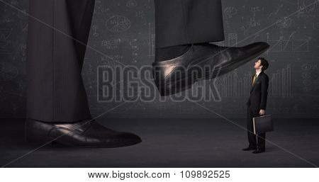 Huge leg stepping on a tiny businnessman concept on background