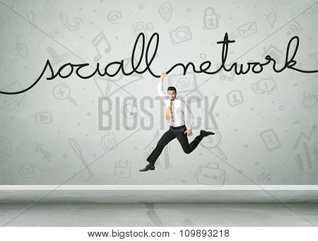 Businessman hanging on a social network rope