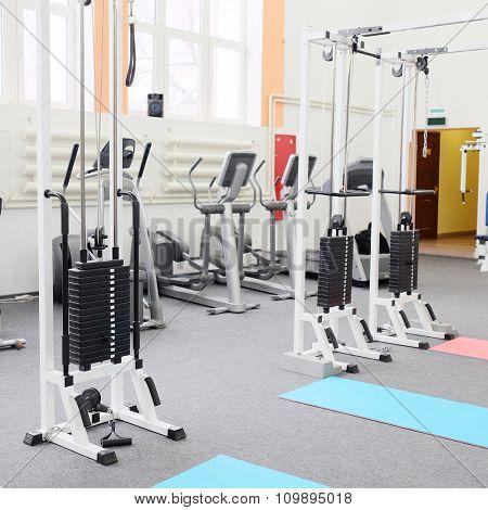 Gym center interior. Equipment, gym apparatus.