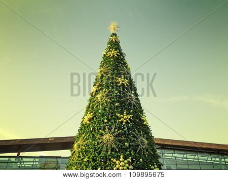 The Top Of The Christmas Tree With A Filtered Sky In The Background In Moscow, Russia