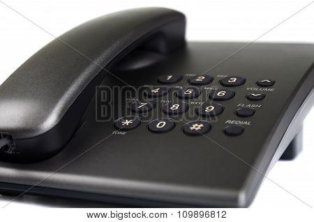 Close-up of black desktop phone.