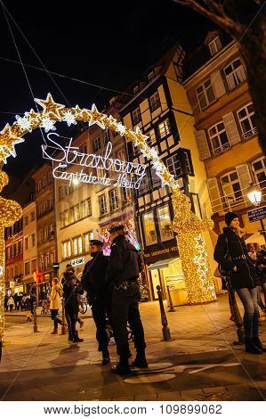 Two Police Officer Surveilling Christmas Market In France