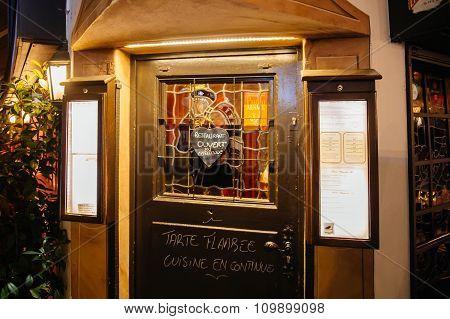 Open Restaurant Door During Christmas Market