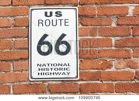 Us Route 66 National Historic Highway Sign On Red Brick Wall, Galena,  Usa