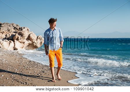 Man Walking With Laptop At The Coast