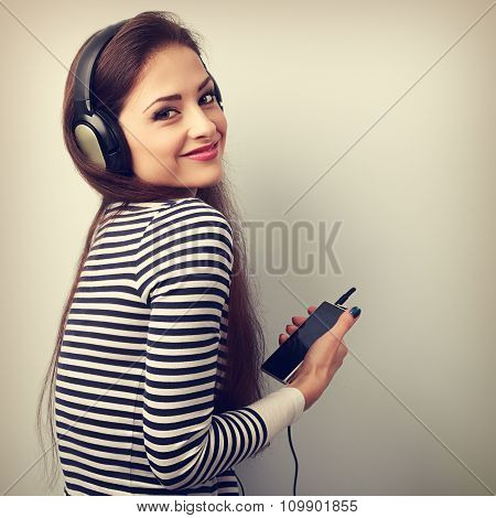 Happy Beautiful Woman Holding Player And Listening Music In Headphones