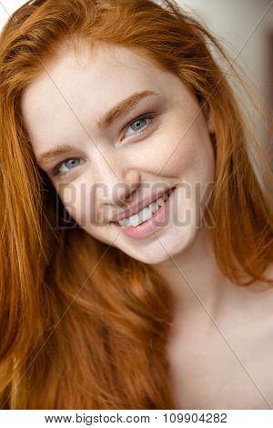 Closeup portrait of charming positive attractive natural young lady with long red hair