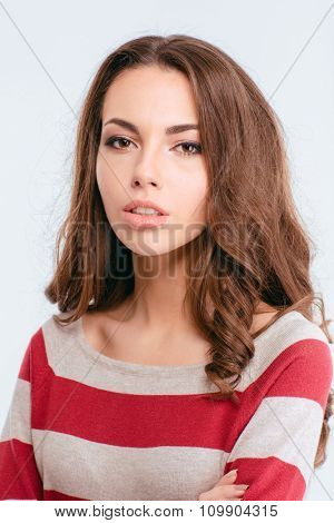 Portrait of a young cute woman looking at camera isolated on a white background