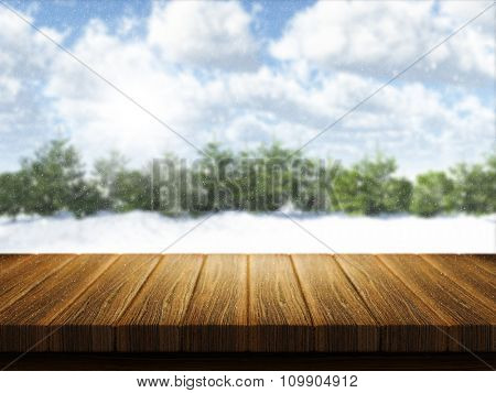 3D render of a wooden table with Christmas snowy landscape defocussed in the background